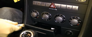 1. Open the little box beneath the radio and remove the screws with a screwdriver.