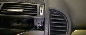 18. Remove two screws holding the radio with a screwdriver.