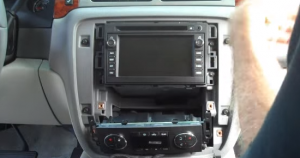 4-2. Remove two screws holding another panel in the dashboard. After that, remove the panel with your hands.