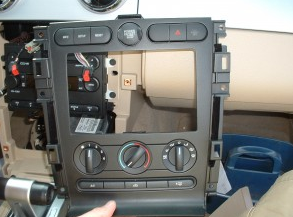 Remove the radio bezel and AC controls