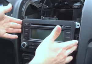 Take the original car radio out of the dash