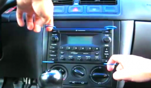 Gently take the original car radio out of the dashboard by pulling the removal keys as the following picture shows