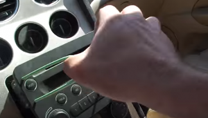 Take the original car radio out of the dash by pulling the cutting hanger