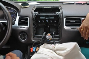 Disconnect the radio antenna at the back of the radio and unplug the electrical plugs running to the back of the radio