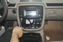 Carefully take the original CD player out of the dashboard