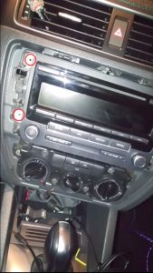 Remove screws that fixed the radio on the dashboard