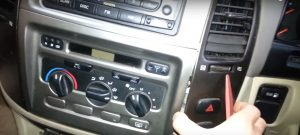 1-1. Remove the panel with a lever and pull it away from dash