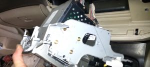 3-1. Take out the car radio and disconnect the wire harness at the back of the unit