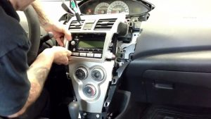 Gently take out the panel on the radio interface
