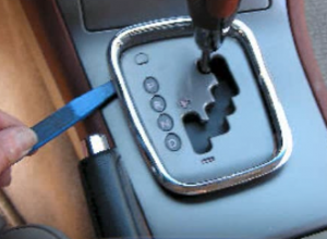 Remove frame around the gear shift