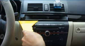 Remove the trim panel with a plastic removal tool
