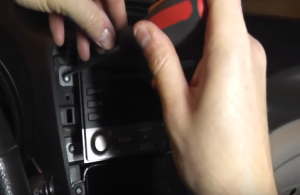 Remove four screws that fixed the head unit on the dashboard