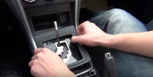 Remove the plastic part around the shift lever