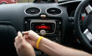 Remove screws that are holding the radio on the dashboard