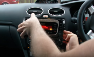 Gently remove the original radio from the dashboard