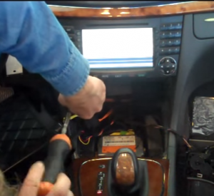 Remove two screws that fixed the original radio on the dashboard