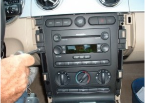 Remove bolts securing radio bezel and AC controls