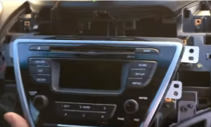 Gently pull out the original car radio. Then unplug the connectors at the back of the factory radio