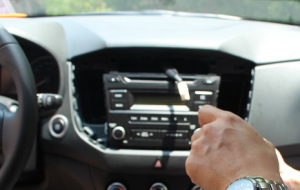 Remove the car radio and unplug the connectors at the back of the radio