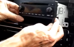 Gently pull the factory radio out of the dash