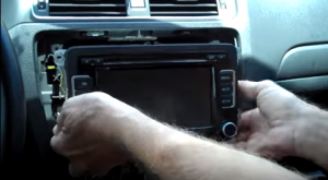 Gently take the original car radio out from the dash by using your hands