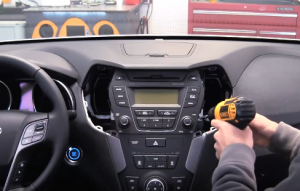 Remove four screws that are holding the radio on the dashboard