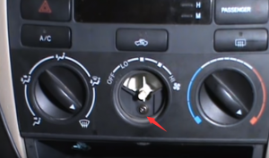 Remove the center button for the heater control panel