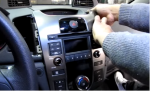Gently take the original car radio out of the dash