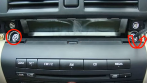 Remove two screws that fixed the car radio on the dashboard