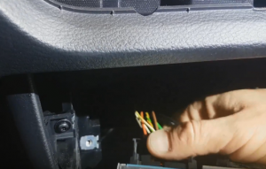 Unplug the connectors and cables at the back of the car radio